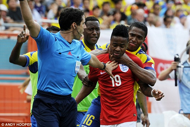 Stranglehold: Valencia grabs Sterling round the throat before the pair are dismissed