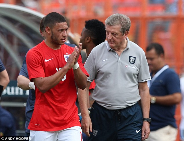 Concern: Roy Hodgson said it is too early to make a decision on what happens next with Oxlade-Chamberlain