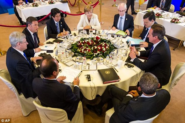 Mr Cameron and Mrs Merkel sat across the table from one another at a breakfast meeting of G7 leaders this morning