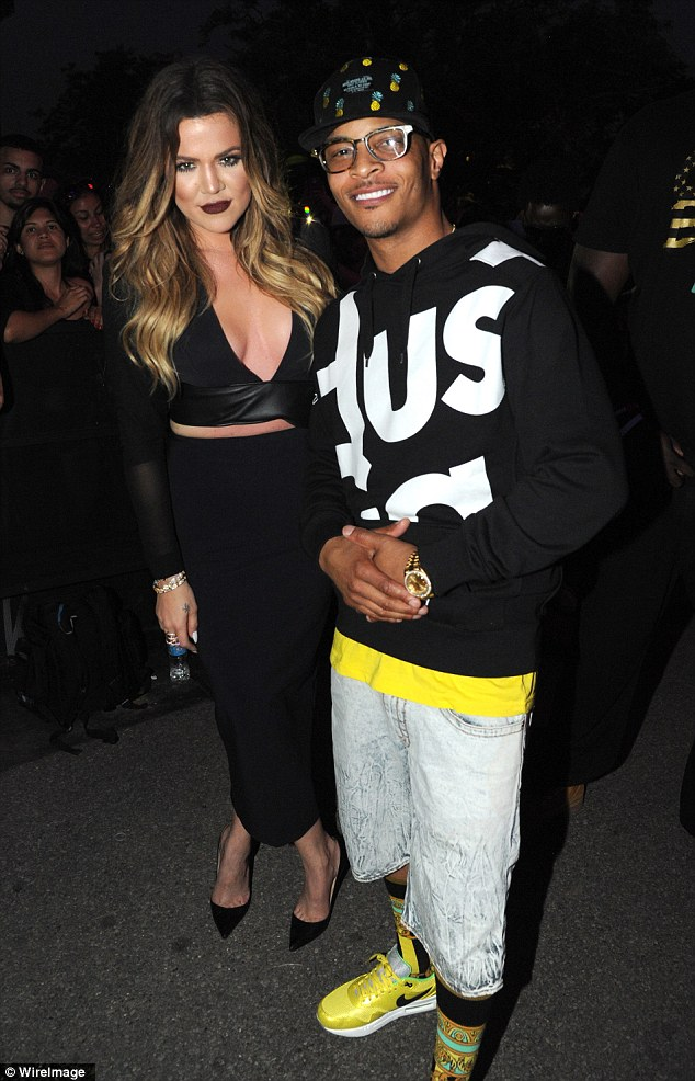 A sultry looking Khloe Kardashian hangs out with rapper T.I backstage at Jennifer Lopez's hometown concert in Bronx, New York on Wednesday