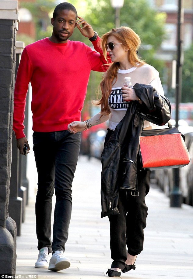 Quiet chat: The two pals conversed as they ventured out, with Lindsay keeping a leather jacket draped over her left arm
