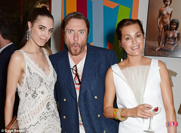 Head of the family: Simon Le Bon poses with his daughter Amber (left) and Yasmin (right)