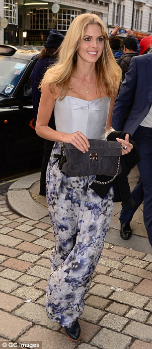 Silver siren: Donna Air arrived in a metallic floral number
