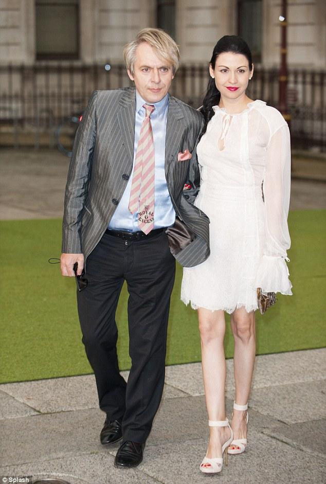 Rock star: Nick Rhodes with his girlfriend Nefer Suvio