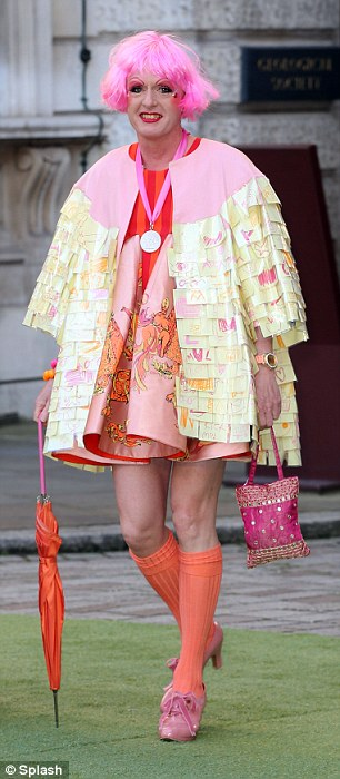 Great designs: Henry Holland (left) and Grayson Perry (right) turn up in flamboyant outfits