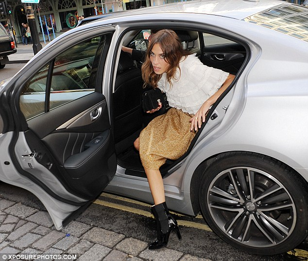 It girl: Alexa cut a chic figure in her ernsemble as she exited the car