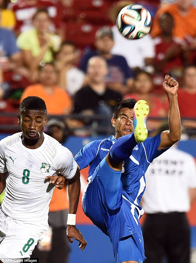 High boot: Solomon Kalou ducks out the way as Milton Molina attempts to clear the ball