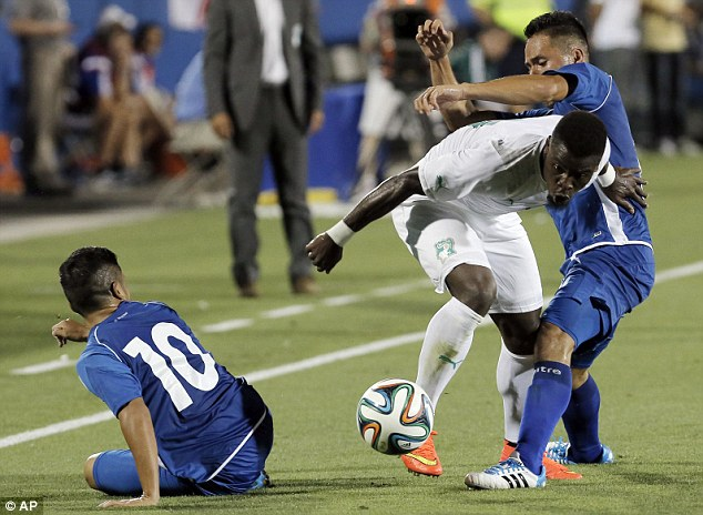 Surrounded: Serge Aurier tries to weave past El Salvador defenders Richard Menjivar and Jamie Alas out on the right flank