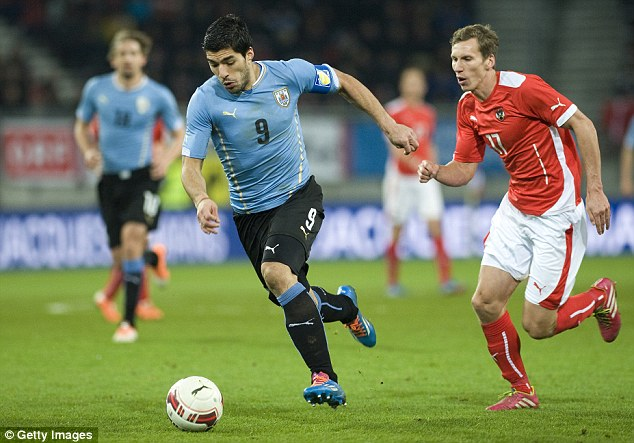 High: Luis Suarez's (left) Uruguay side are the top-ranked in Group D, which contains England, in seventh