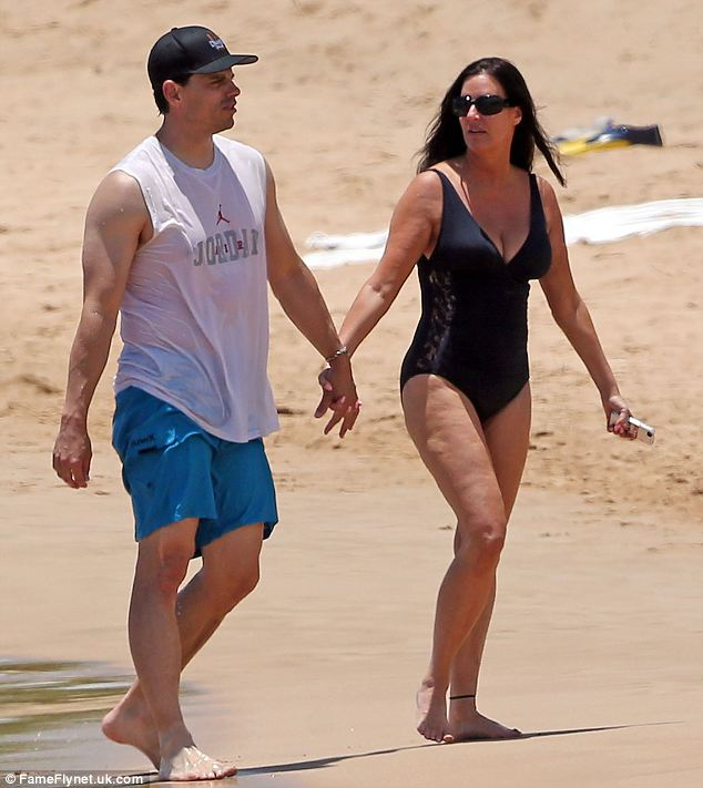 Bliss: Millionaire Matchmaker star Patti Stanger and her fiance David Krausse enjoy her 53rd birthday on the beach in Maui, Hawaii
