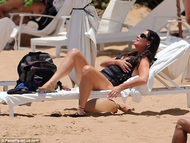 Chilled out: Patti reclines on a beach lounger to make the most of the sun