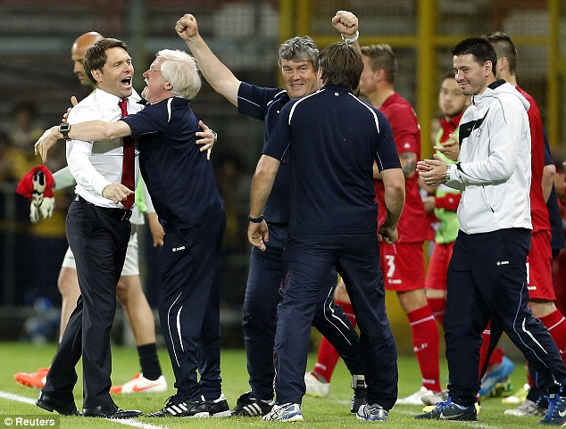 Hand it to them: Luxembourg coach Luc Holtz (left) and his staff celebrate holding Italy to a draw