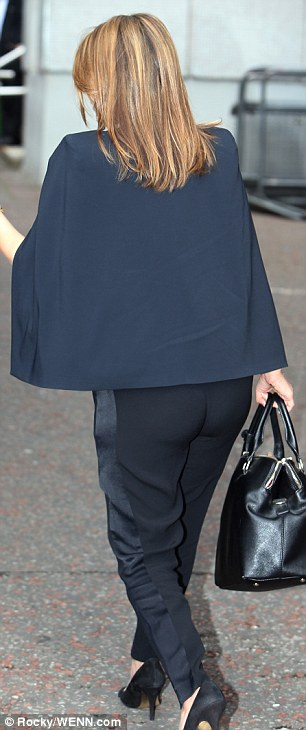 Sheer daring: The former pop princess cast aside her supermarket chic in favour of a sexy semi-sheer top, which revealed a cheeky hint of her black lace bra, and smart tailoring