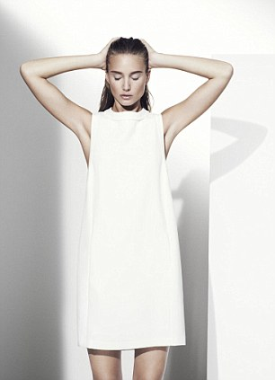 A fashion model poses in sleeveless dress, £69, M&S