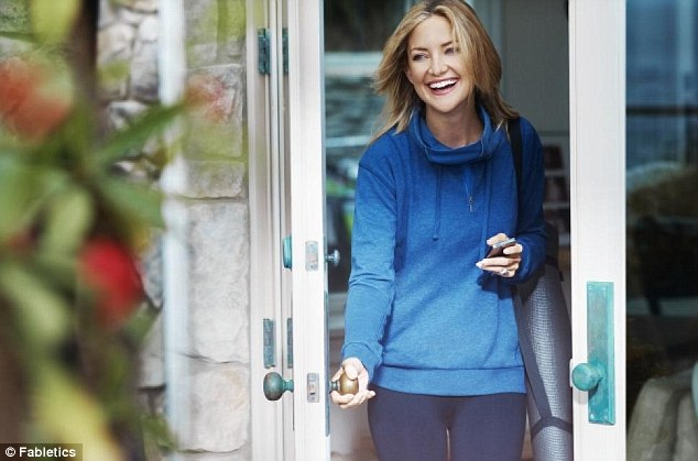 Beautiful in blue: Kate modeled a sweatshirt from her Fabletics line