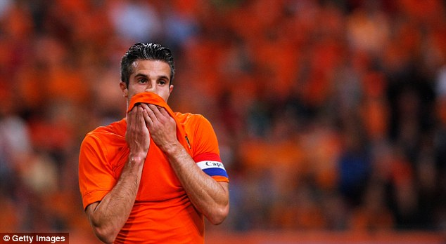 Injury scare: Van Persie was taken off at half time with a potential groin injury during Holland's 2-0 win