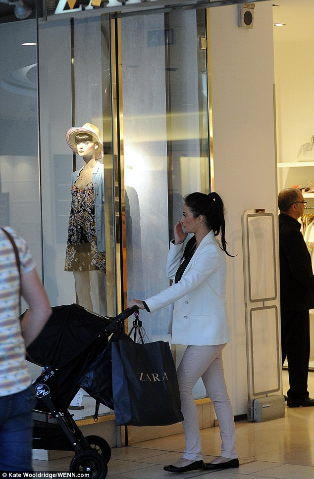 Treat: Chantelle was seen leaving clothing store Zara with a bag