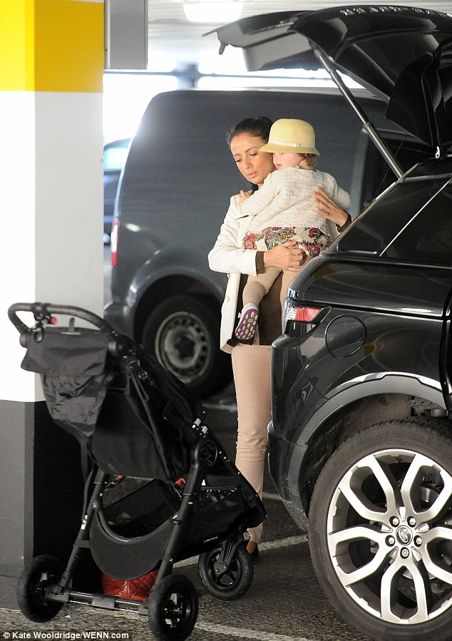 Easy does it: Chantelle took care as she sat Dolly in her buggy in the car park