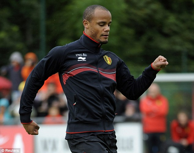 In charge: Kompany is captain at Manchester City and will lead Belgium through the World Cup in Brazil