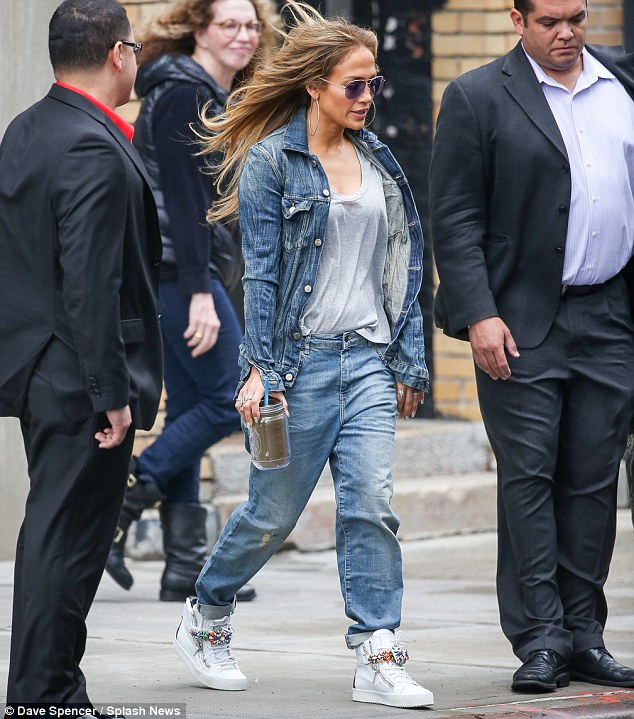 Business as usual: J-LO out in double denim on Thursday in New York City