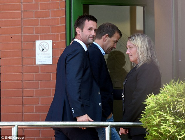 New home: Deila makes his way into Celtic Park ahead of his first press conference as the club's manager