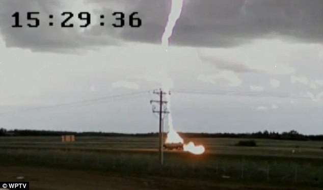 Shocking: The lightning lights up the sky as it strikes a pick up truck on Saturday