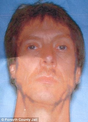 Suspect: Dennis Marx was shot dead as he arrived at court with an assault rifle