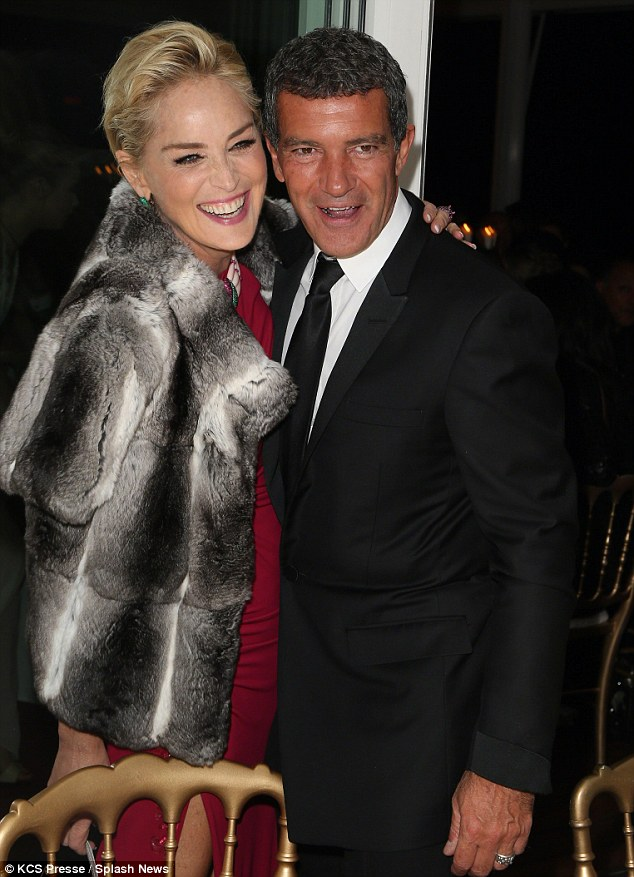No romance here: On Thursday Sharon Stone, pictured with Antonio Banderas on May 20 at the Cannes Film Festival, told MailOnline she was not dating the Mask Of Zorro star