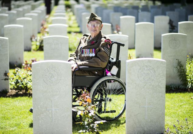 Memory: 99-year-old Ken Scott of the Durham Light Infantry at The Commonwealth War Graves Commission Cemetery in Bayeux