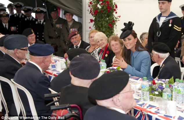 All smiles: The Duchess chatted and laughed with numerous veterans at the tea, held in Arromanches