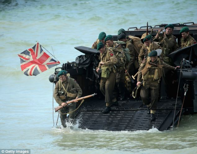 Action: Today, actors recreated the scenes in Arromanches 70 years ago - storming up Gold Beach for hundreds of veterans and other special guests including The Duke and Duchess of Cambridge