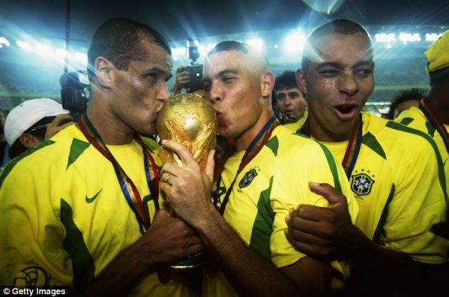 Years later Brazil would go on to become global footballing superpowers. Pictured left to right, Rivaldo, Ronaldo and Gilberto Silva celebrate winning the World Cup in 2002