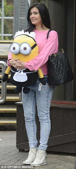 She's happy: Kym must have a got a few good shots in as she won a cuddly toy