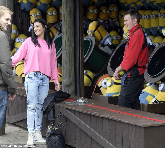 Fun and games: Kym seemed like she was having great fun at the fairground attraction