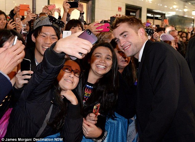 Popular with the ladies! The English star joked that he was busy getting numbers on the red carpet