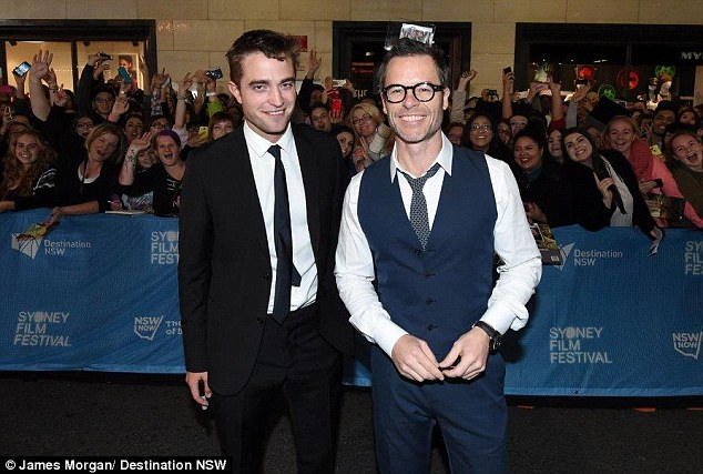 The main attraction: Scenes on Sydney streets were compared to the days of Beatle-mania, as R-Patz posed alongside co-star Guy Pearce