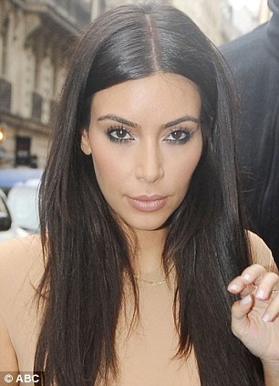 Striking resemblance: Claudia looks surprisingly like her idol Kim Kardashian (right)