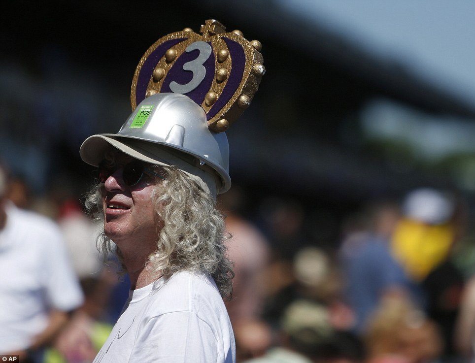 Feeling lucky: A crown with the number 3 attached adorns a silver construction hat worn by a fan of California Chrome