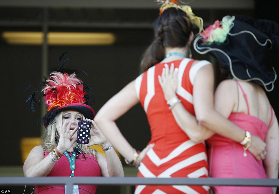 Flight of fancy: Kylie Fouchee, left, takes a photo of Vicku Dimitri, center, and her mother, Linda, at Belmont Park