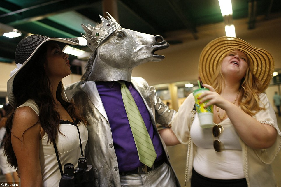 Fun-filled: Mike Calimano topped off his horse head mask with a crown in anticipation of a historic win