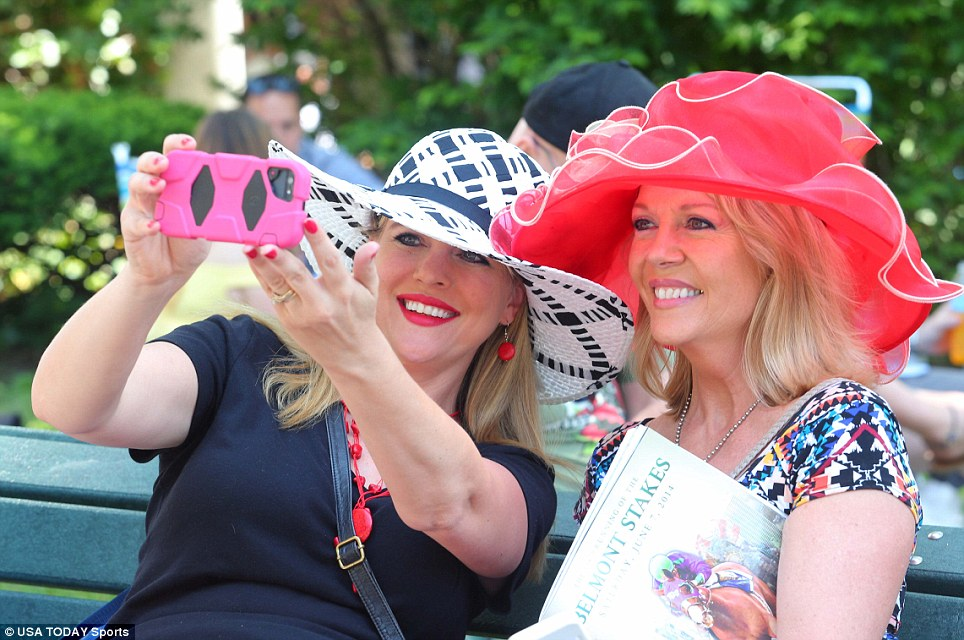 Race day: Elegant and brightly colored hats were the order of the day as racegoers headed to the Long Island track