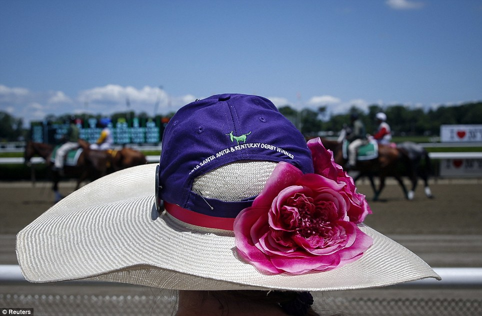 Track side: A woman watches horses line up for an earlier race at Belmont Park on Saturday