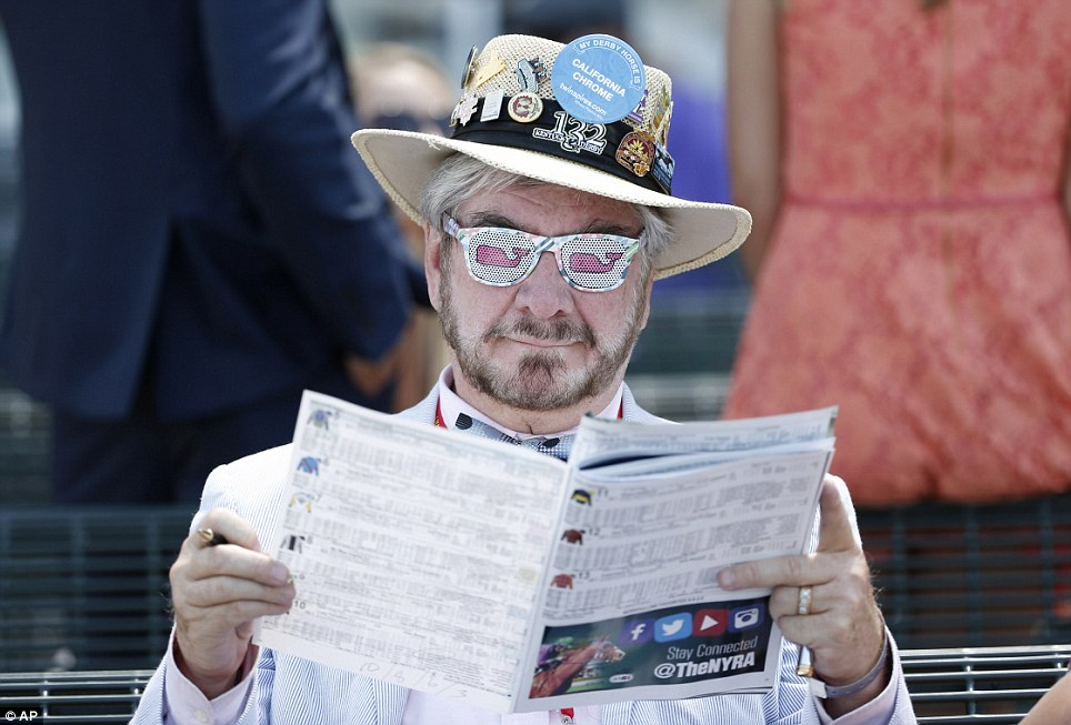 Race card: A horse racing fan studies the form in between events