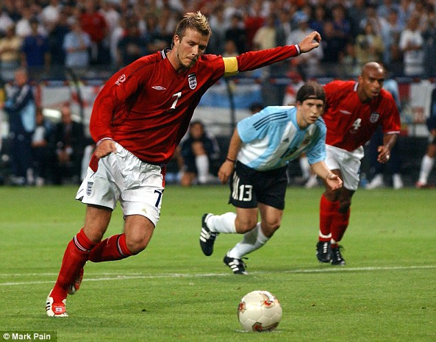 Strike: Beckham smashed his penalty low and hard to secure England a 1-0 win over Argentina