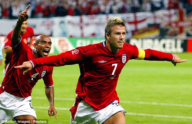 Captain fantastic: David Beckham celebrates his goal against Argentina at the Sapporo Dome in 2002