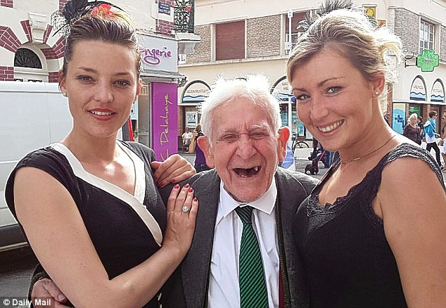 Joyful: The former Royal Navy Lieutenant is pictured with cousins Anne-Sophie and Aude Corbin in Ouistreham
