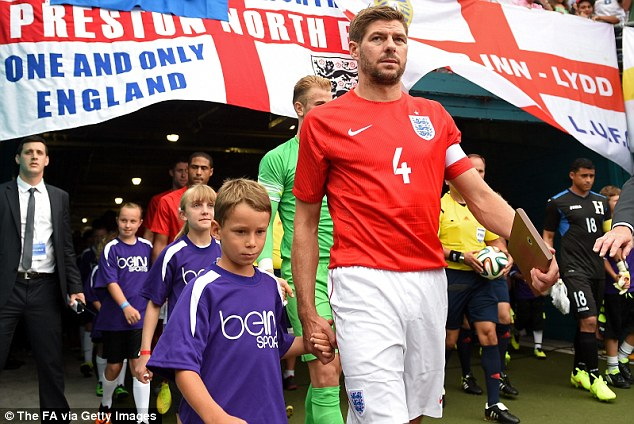 Captain's role: Steven Gerrard's experience will also be vital in Brazil believes Beckham