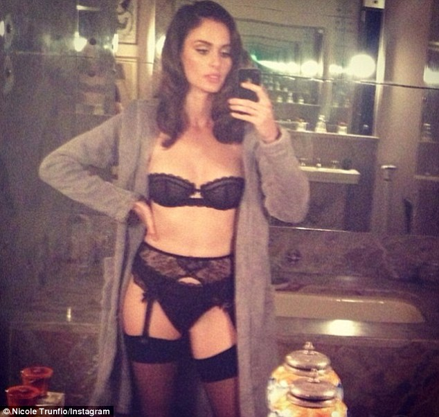 Sexy: The Australian model flaunted her figure in black lace lingerie for a series of raunchy selfies while doing the Pirelli shoot