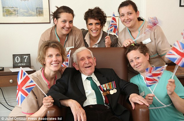 Safely back in Blighty: Staff at Pines Care Home in Hove, East Sussex give Bernard Jordan, 89, a special welcome on his return