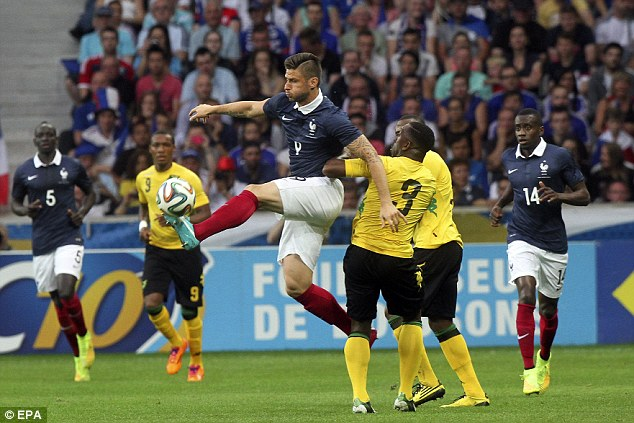 In control: Olivier Giroud linked well with Benzema, eventually converting a cross to make it four
